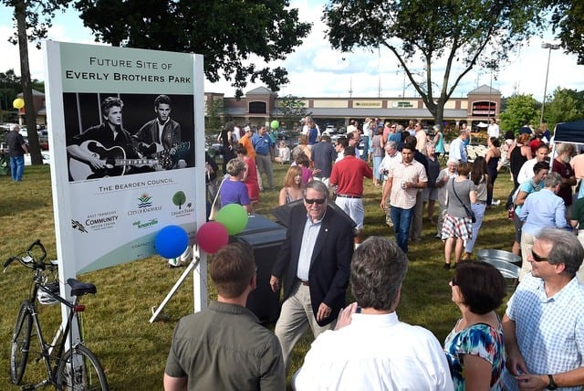 Councilman Duane Grieve, center, mingles with attendees following a dedication ceremony at Everly Brothers Park on Friday, Aug. 7, 2015. (ADAM LAU/NEWS SENTINEL)