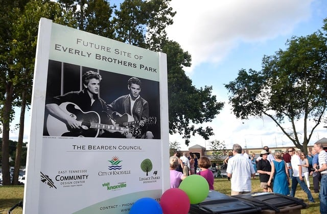 Attendees gather following a dedication ceremony at Everly Brothers Park on Friday, Aug. 7, 2015. (ADAM LAU/NEWS SENTINEL)