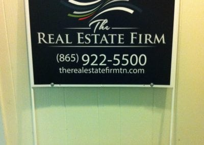 The Real Estate Firm sign